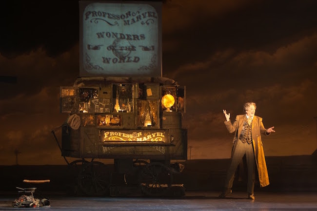 Professor Marvel brings his magical wagon to Kansas in THE WIZARD OF OZ stage adaptation.